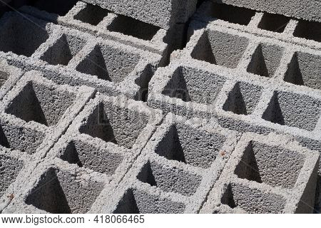 Stacked Hollow Concrete Blocks, Harsh Shadows, Background