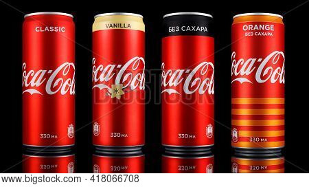 Moscow, Russia - April 14, 2021: Coca-cola Red Aluminum Cans With Different Flavors In Row With Refl