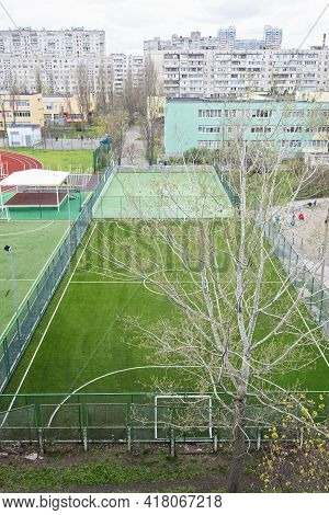 Open City Sports Grounds For Playing Football. Stadium, Empty Astro Turf Football Field During Lockd