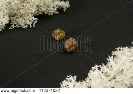 Madagascar Or Pakistani Garnet Natural Unpolished Mineral Stone On A Black Background. Mineralogy, G