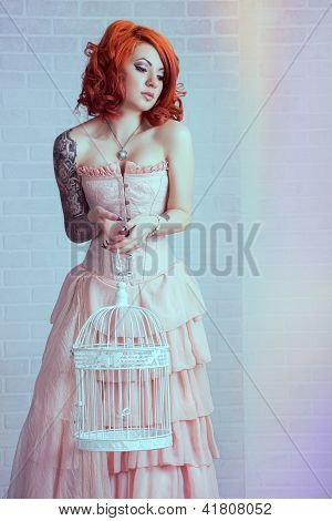 Sensual young woman with red hairs posing in studio poster