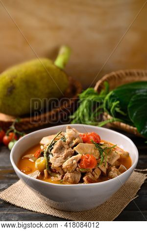 Northern Thai Food (kang Kanoon), Spicy Young Jackfruit Soup With Pork In A Bowl On Wooden Table