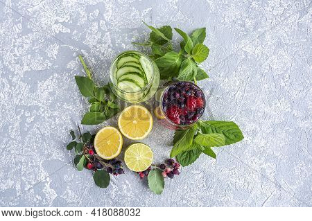 Variety Of Fresh Cool Detox Drink With Berries And Cucumber. Glasses Of Lemonade Or Flavored Infuse