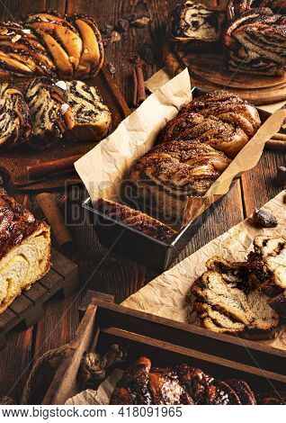 Still Life Of Various Type Of Babka Sweet Swirl Sourdough Bread On Wooden Background