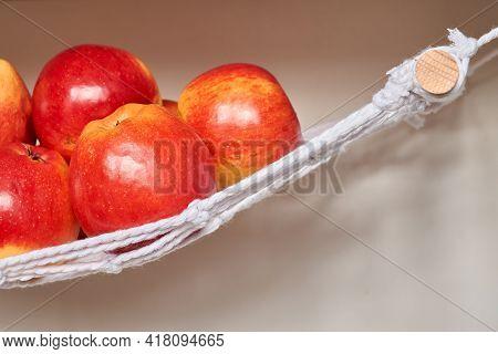 Red Apples In A Hammock. Fruit And Veggie Hammock Macrame. Under Cabinet Produce Hammock. Zero-waste