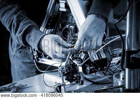 Two Male Masters Work In The Workshop With Electronics, Wires, 3d Printer.