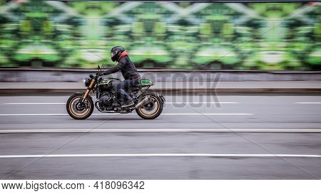 Moscow, Russia - April 2021: Fast Moving Bmw R Ninet On Highway With Blurred Background. Motorcyclis