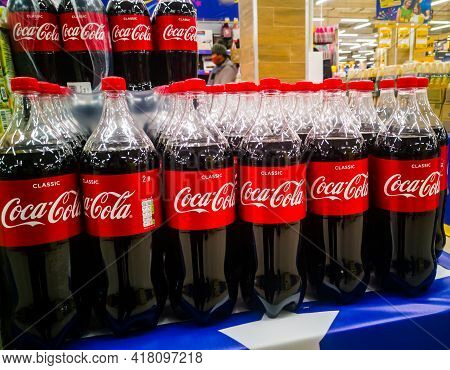 Bottles Of American Fizzy Drink Coca-cola Are Compiled For Sale At A Discount In The Grocery Hyperma