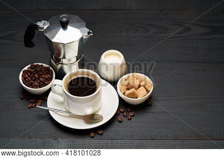 Cup Of Espresso Coffee, Mocha Coffee Maker Milk Or Cream And Brown Sugar On Dark Wooden Background