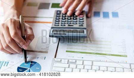 Close Up Accountant Or Financial Expert Analyze Business Report Graph And Finance Chart At Corporate