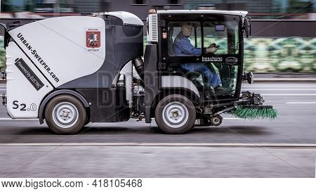 Sweeper Machine On The Road In The City. Community Road Services, Street Cleaning Concept. A Small S