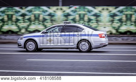 Moscow, Russia - April 2021: Typical Police Car In The Moscow Streets. Skoda Octavia In Motion On Ur