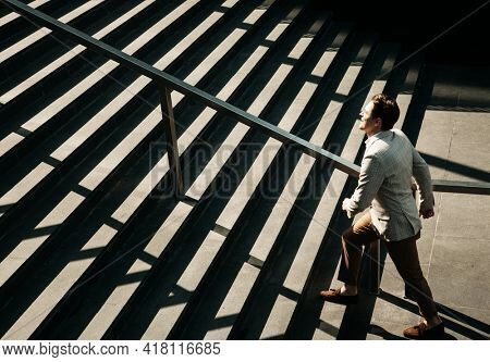 Business and people concept: Young Business man going up the stairs