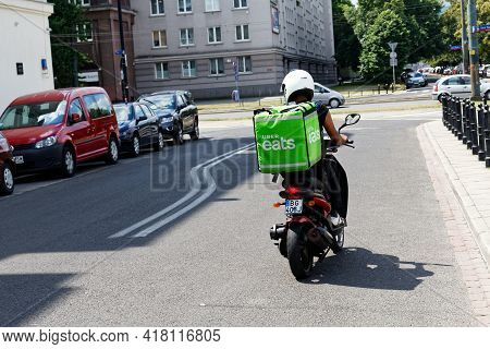 Warsaw/poland - June 16, 2018: Food Supplier Riding On Motorcycle With Uber Eats Bag On His Back