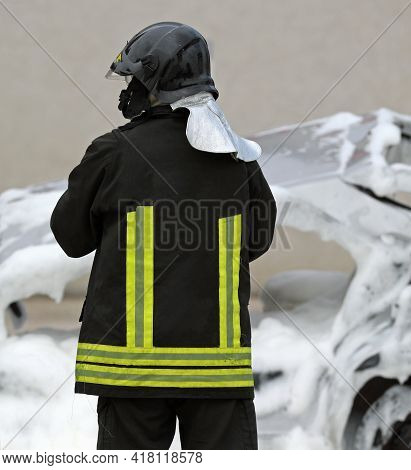 Italian Fire Fighter With Uniform And The Text That Means Firemen In Italian Language