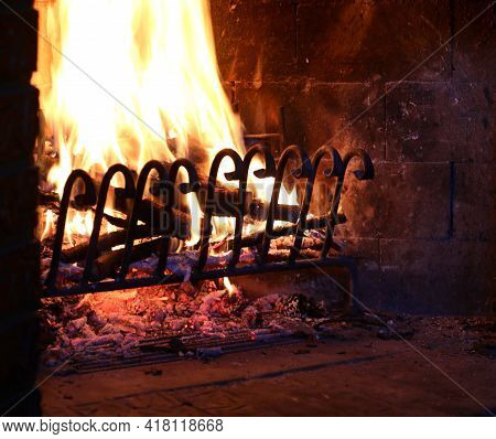 Fireplace With Warm Lit Fire Symbol Of The Warmth Of The Reassuring Abode