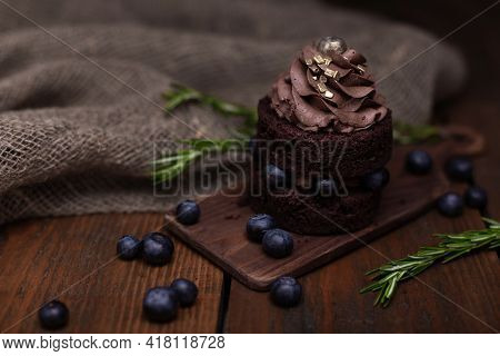 Gluten Free Cake With Blueberry And Carob. Homemade Chocolate Cake With Berries And Rosemary On Brow