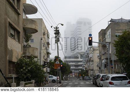 Tel Aviv, Israel - April 16th, 2021: A Foggy Morning In A Southern Tel Aviv, Israel, Street.