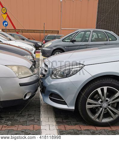 Two Rows Of Parked Cars In Parking Lot. Two Cars Parked Bumper To Bumper In Warsaw, Poland. 13.04.20