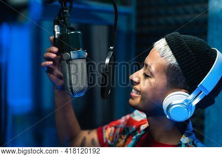 Young Professional Female Singer Recording A New Song Album Inside Music Production Studio