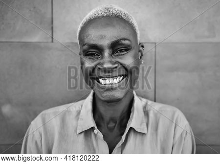 Happy Afro Woman Portrait - African Senior Female Having Fun Smiling In Front Of Camera - Black And