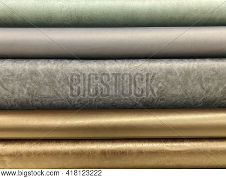 Bolts Of Metallic Fabric In A Fabric Store