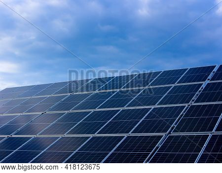 Solar Panels On The Street Against The Blue Sky. Solar Power Plant In The Countryside. Generation Of