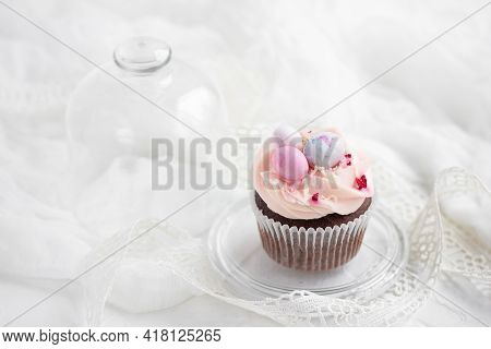 Easter Chocolate Cupcake With Caramel Filling And Decoration In The Form Of Small Easter Eggs From M