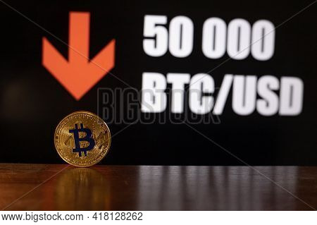 Bitcoin Market Price Drops Under 50 000 Usd (us Dollars). Hand Holding Bitcoin And Price In The Back