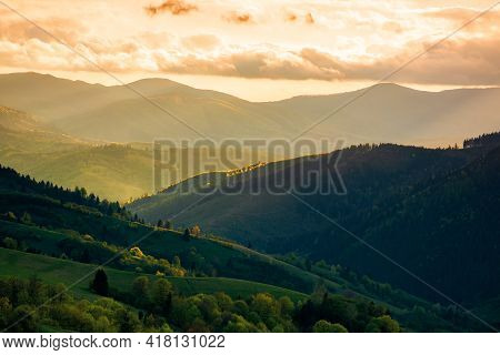 Rural Landscape In Mountains At Sunset. Dramatic Weather Above The Distant Valley In Springtime. Gre