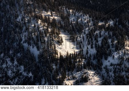 Aerial View From Airplane Of Snow Covered Canadian Mountain Landscape In Winter. North Of Vancouver,