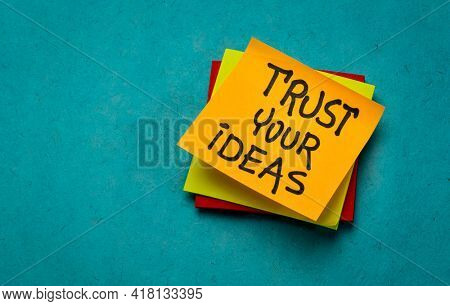 trust you ideas - inspirational reminder, handwriting on sticky notes, self-confidence and personal development concept