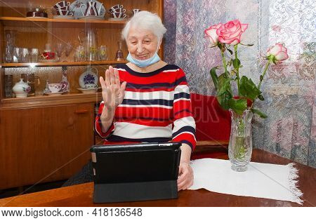 Covid-19 Stay Connected. Happy Senior Woman At Home Video Calling Family On Laptop Or Online Chattin