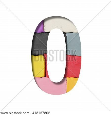 Multi-colored Plasticine Font. The Digit Zero, 0 Is Cut Out Of Paper On A Background With A Piece Of