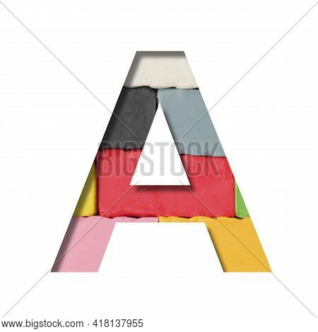 Multi-colored Plasticine Font. Letter A Cut Out Of Paper On A Background Of Pieces Of Colored Plasti