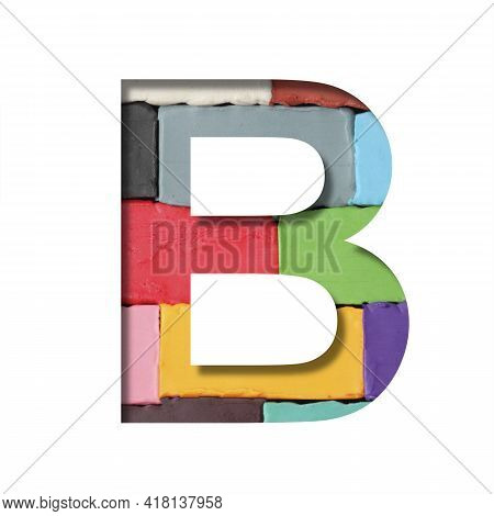 Multi-colored Plasticine Font. Letter B Cut Out Of Paper On A Background Of Pieces Of Colored Plasti
