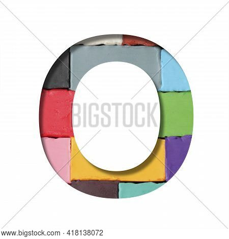 Multi-colored Plasticine Font. Letter O Cut Out Of Paper On A Background Of Pieces Of Colored Plasti
