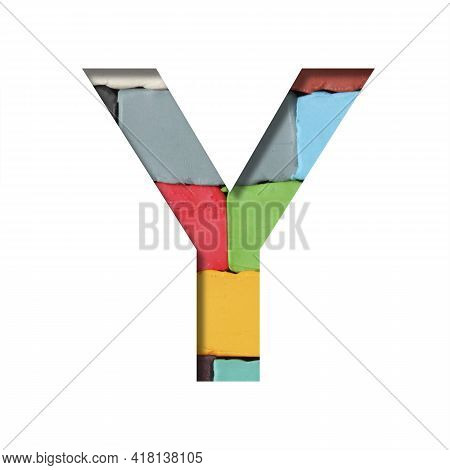 Multi-colored Plasticine Font. Letter Y Cut Out Of Paper On A Background Of Pieces Of Colored Plasti