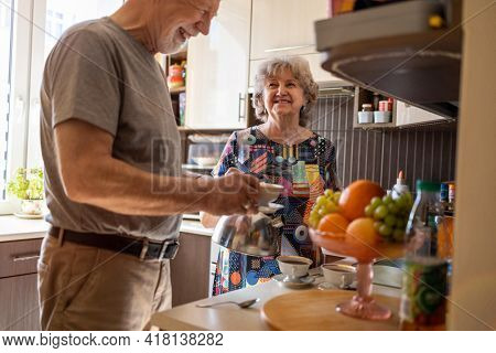 Senior couple together in their kitchen at home