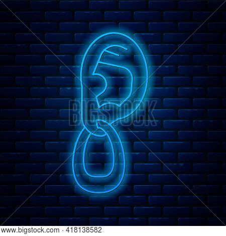 Glowing Neon Line Ear With Earring Icon Isolated On Brick Wall Background. Piercing. Auricle. Organ