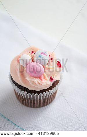 Easter Chocolate Cupcake With Caramel Filling And Decoration Of Small Easter Eggs From Marzipan. Sel