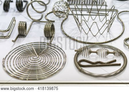 Various Types Of Sample Parts Metal Wire Bending Workpiece Such As Spring Coil Etc . After Forming M