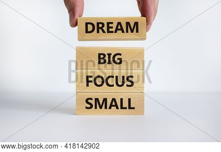 Dream Big Focus Small Symbol. Concept Words 'dream Big Focus Small' On Wooden Blocks On A Beautiful