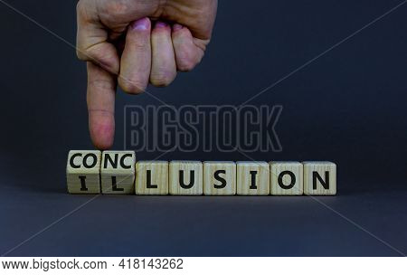 Conclusion Or Illusion Symbol. Businessman Turns Wooden Cubes And Changes The Word 'illusion' To 'co