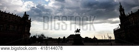 Night skyline Statue of the saxon King Johann in front of the opera house Semperoper on the Theatre square in Dresden. At sunrise time