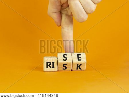 Risk Vs Rise Symbol. Businessman Turns Wooden Cubes And Changes The Word Risk To Rise. Beautiful Ora
