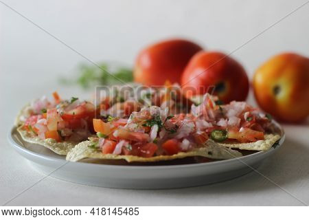 Crisp And Fried Papads Topped With A Masala Filling Of Onions, Tomatoes And Spices. Popular Starter