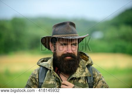 Hunting Season. Animal Hunt. Brutal Man Poacher. Male Adventures. Beard Guy Hiking With Backpack. Ma