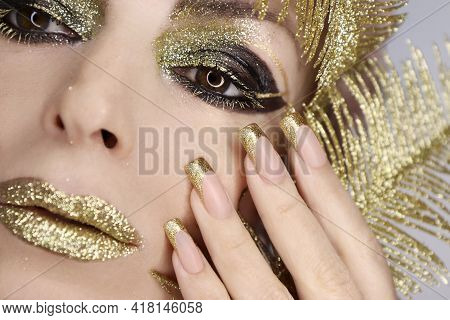 Fashionable Golden Makeup And French Manicure On Square Shaped Nails.