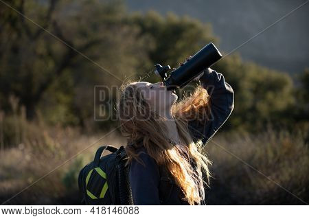 Woman Traveler Drink Water. Female Hiker With Backpack At Mountain. Girl Hiking A Hill At Panoramic